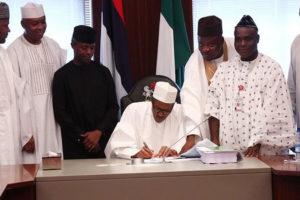 buhari-signing